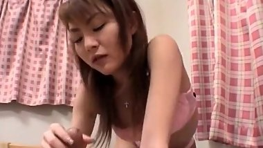 Rina Kangi in pink lingerie plays with cock while sucking it
