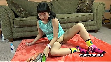 Asian wife Yuka Ozaki fucks her pussy with a big cucumber