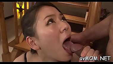 Floozy asian mom deepthroats large weenie and her pussy fingered