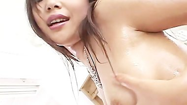 Cute Japanese doll Saki Ogasawara fucks herself