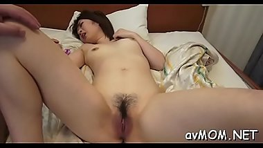 Asian beauty deepthroats weenie while she gets her hairy pussy teased